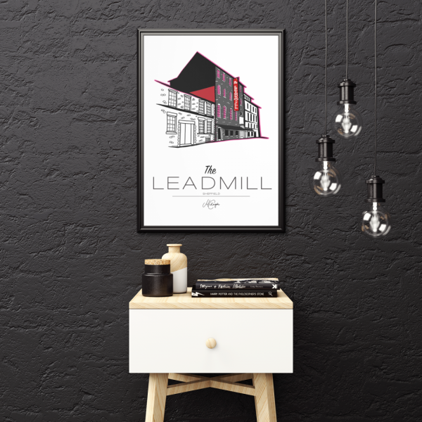 framed art print mockup featuring a small minimal table and some hanging light bulbs 3935 el1 1